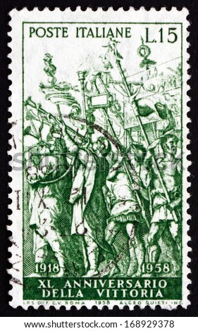 ITALY - CIRCA 1958: a stamp printed in the Italy shows The Triumph of Caesar, Painting by Montegna, 40th Anniversary of Italy's Victory in World War I, circa 1958 - stock photo