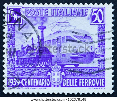 ITALY - CIRCA 1939: a stamp printed in the Italy shows Wood-burning Engine and Streamlined Electric Engine, Centenary of Italian Railroads, circa 1939 - stock photo