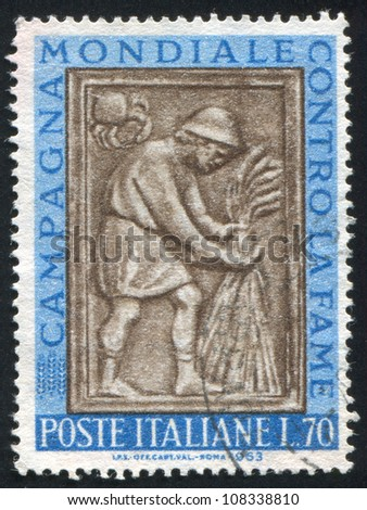 ITALY - CIRCA 1963: stamp printed by Italy, shows Harvester tying sheaf, sculpture from Maggiore Fountain, Perugia, circa 1963 - stock photo