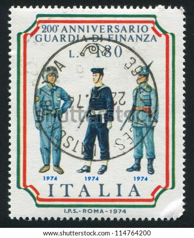 ITALY - CIRCA 1974: stamp printed by Italy, shows Helicopter pilot, Naval and Alpine guards, circa 1974 - stock photo
