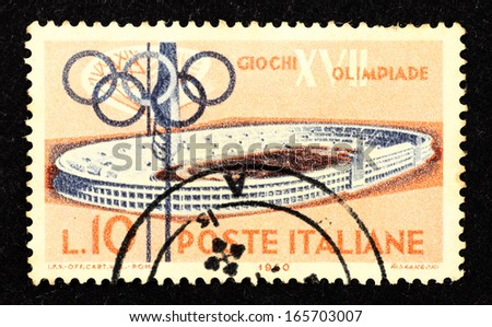 ITALY - CIRCA 1960 : Stamp printed in Italy with the image of a velodrome stadium to commemorate the 17th Olympic Games in Rome, circa 1960.