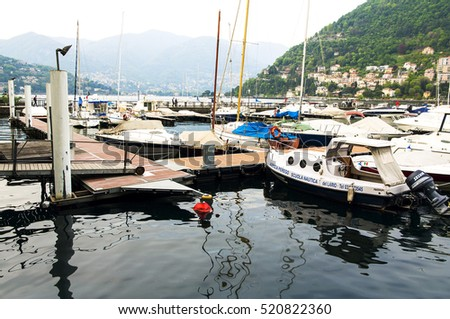 ITALY. COMO - APRIL 21, 2016: Pleasure yachts and boats at the pier on the waterfront of Lake Como.