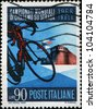 ITALY - CRICA 1968: A stamp printong in Italy honoring World Road Cycling Championships shows Cyclists and Imola Castle, circa 1968 - stock photo