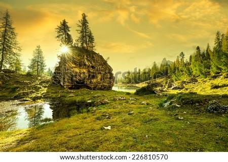 Italy, Dolomites - sunrise behind the rocks - stock photo