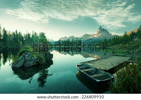 Italy, Dolomites - the beautiful lake at dawn to reveal a bluish green world - stock photo