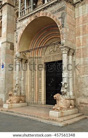 Italy Ferrara old cathedral main door - stock photo