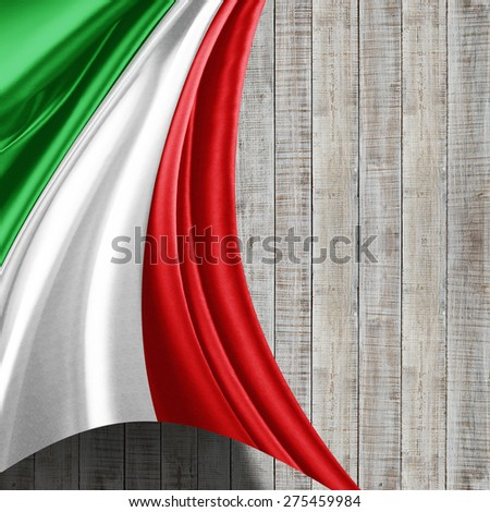 Italy flag of silk and wood background
