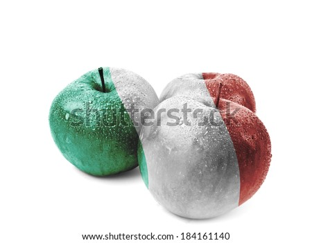Italy flag on three apples isolated on white. The photograph shows the country as one of the largest producers of apples in the world.