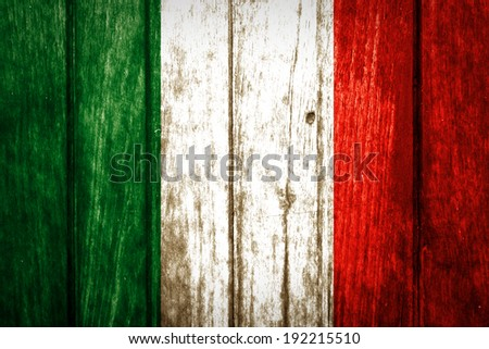 Italy flag painted on old wood background - stock photo