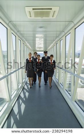 Italy, flight assistants in a Finger. soft focus - stock photo