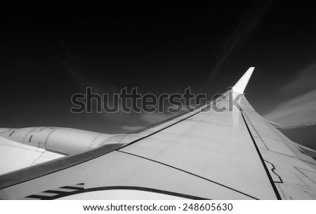 Italy, flying airplane wing - stock photo