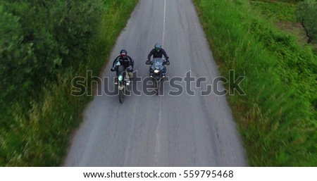 italy, hills of tuscany, camera car of Two motorcyclists on mountain highway having fun and enjoying road, no logos shot NO LOGOS in the shoot