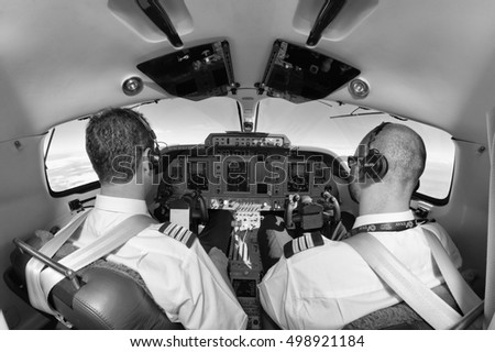 Italy; 26 July 2010, pilots in a flying airplane's cockpit - EDITORIAL