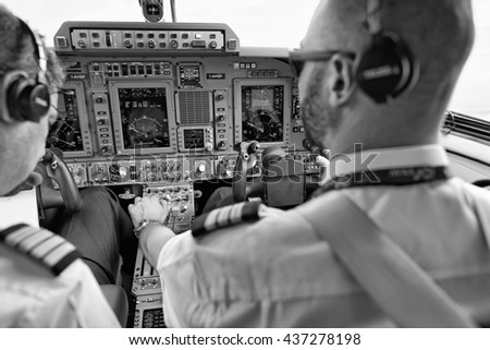 Italy; 26 July 2010, pilots in an flying airplane's cockpit - EDITORIAL