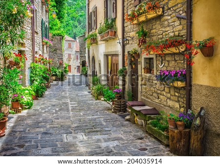 ITALY - JUNE 23, 2014: Typical Italian street in a small provincial town of Tuscan, Italy, Europe - stock photo