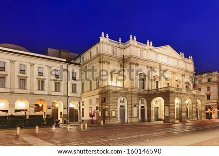 Italy lombardy milan city landmark la scala theater building illuminated with lights at sunrise facade neo classical style nobody - stock photo