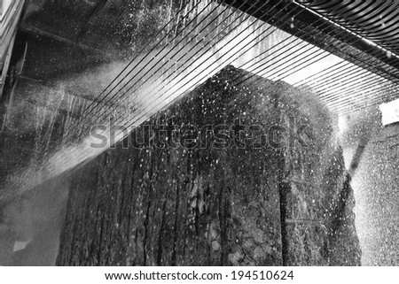 Italy, marble factory, marble cooled with water while being cut - industrial - stock photo