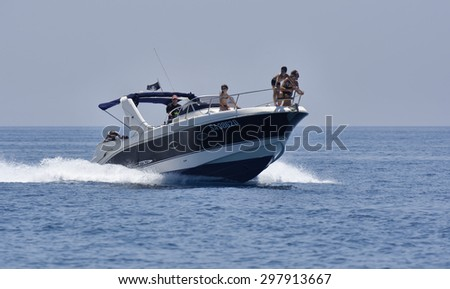 Italy, Mediterranean Sea; 18 july 2015, off the South-East sicilian coast, people cruising on a luxury yacht - EDITORIAL