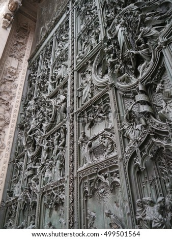 Italy / Milan Cathedral / picture showing the beautiful door of the Duomo Cathedral in Milan, taken in 2014