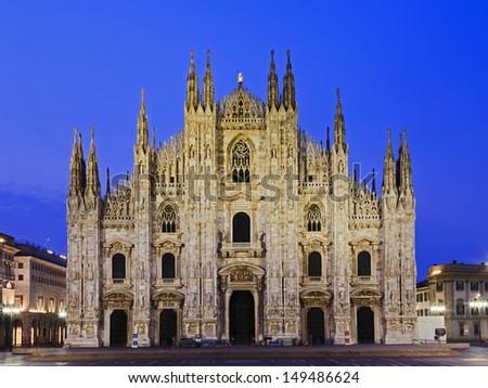 Italy Milan city gothic cathedral facade view at sunrise catholic landmark  - stock photo