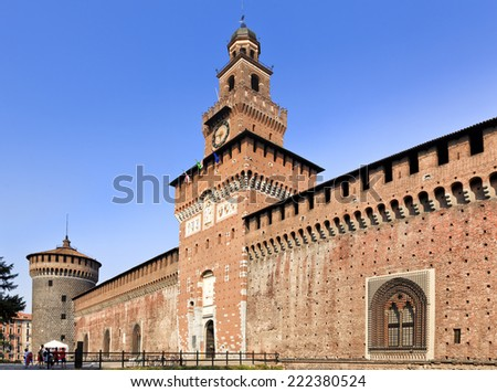 Italy Milan sforzesco castle ancient red bricks and stone walls, towers and gate side view sunny day under blue sky
