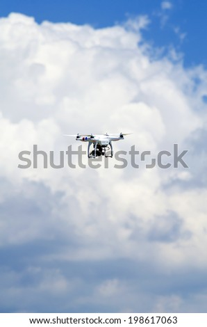 italy,modena circa may 2014 - flying drone in action filming the clouds in spring time