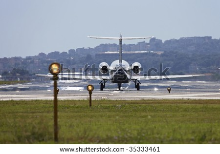 ITALY, Naples, international airport Capodichino, airplane ready to take off and flight control lights - stock photo