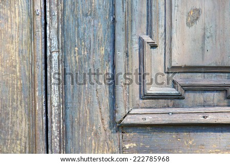 italy  patch lombardy    cross castellanza blur   abstract   rusty brass brown knocker in a  door curch  closed wood  - stock photo