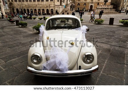 ITALY, PERUGIA - SEPTEMBER 27, 2015: The Volkswagen Beetle car with a wedding bow on the central square of Perugia.