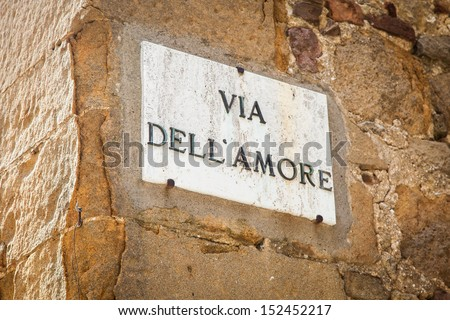 Italy - Pienza town. The streetsign of Via dell'amore (Love Street)