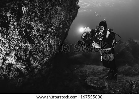 Italy, Ponza Island, Tyrrhenian sea, U.W. photo, filming scuba diver   - stock photo