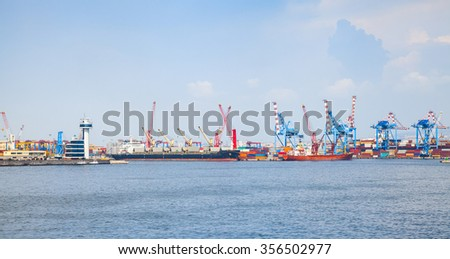 Italy. Port of Naples, coastal cityscape with cargo ships near container terminal