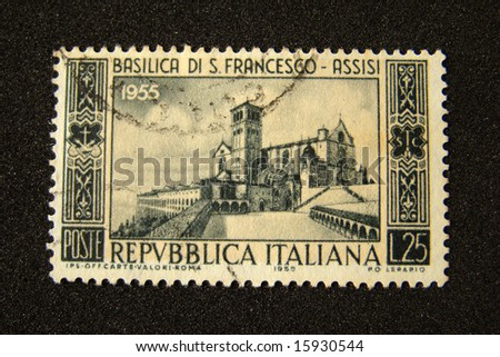 Italy postage stamp on black background.