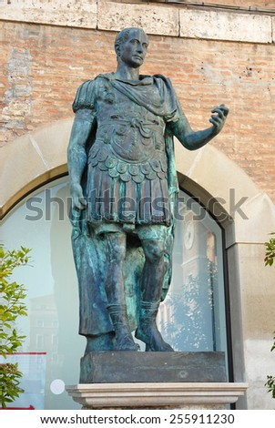 Italy, Rimini, Julius Cesar statue in the central tre martiri  square. - stock photo