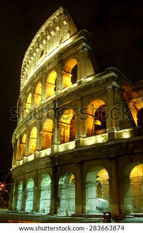 ITALY, ROME - FEBRUARY 22: Colosseum by night at February 22, 2003 in Rome,  Italy. Colossuem is the symbol of ancient Rome. - stock photo