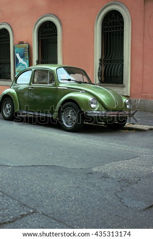 Italy, Rome January 31, 2016: A green Volkswagen Beetle - stock photo