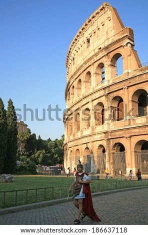 ITALY, ROME - JUNE 23, 2008: Evening Colosseum - elliptical amphitheatre in the centre city, largest amphitheatre in the world, one of the greatest works of Roman architecture and engineering. - stock photo