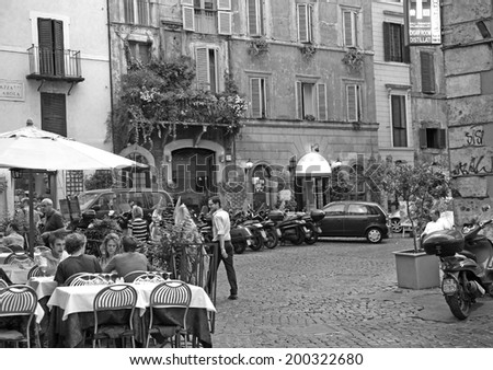 ITALY, ROME - JUNE 25, 2008: Evening summer view one of the famous restaurant on Piazza Pollarola - people communicate, relax and enjoy.  - stock photo