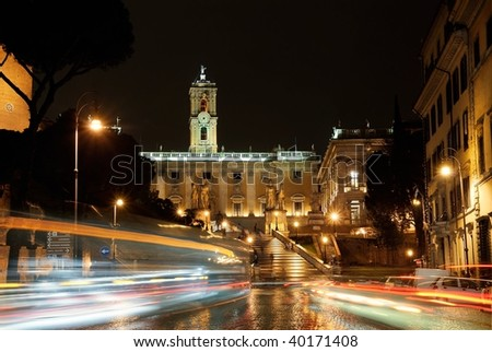 Italy. Rome. Piazza d'Aracoeli at night and auto traffic