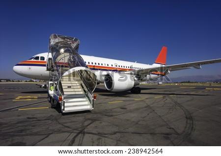 Italy, Sardinia, Olbia International Airport, airplane on the runway - stock photo