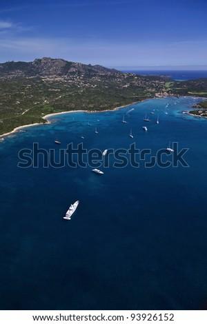 Italy, Sardinia, Olbia province, Emerald Coast, aerial view of luxury yachts in Cala Volpe Bay - stock photo