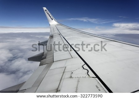 Italy; 30 september 2015, flying airplane wing - EDITORIAL - stock photo