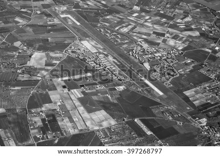 Italy, Sicily, aerial view of the sicilian countryside and Comiso airport (Ragusa Province)