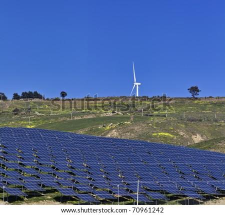 ITALY, Sicily, Agrigento province, countryside, Eolic energy turbine and solar energy panels - stock photo