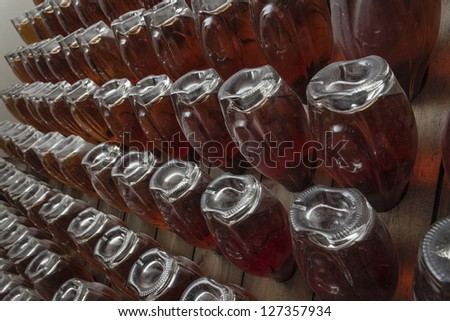 Italy, Sicily, champagne bottles aging in a wine cellar