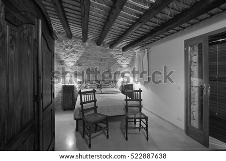 Italy, Sicily, countryside in Ragusa Province; 17 August 2005, interiors of an old sicilian stone house, bedroom - EDITORIAL