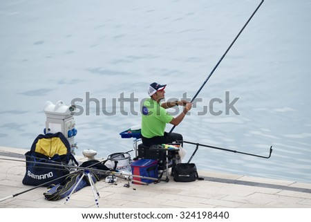 Italy, Sicily, Marina di Ragusa; 4 october 2015, fisherman in the port - EDITORIAL - stock photo