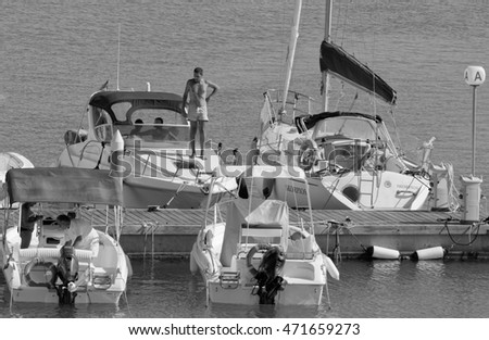 Italy, Sicily, Mediterranean Sea; 21 August 2016, people on their motorboats in the port - EDITORIAL