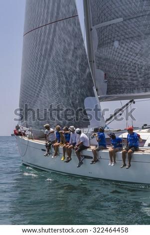 Italy, Sicily, Mediterranean Sea; 30 june 2012, sailboat crew during a race - EDITORIAL - stock photo