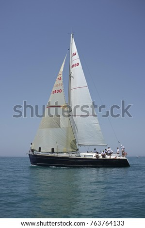 Italy, Sicily, Mediterranean Sea, Marina di Ragusa; 30 june 2012, people on a sailing boat - EDITORIAL